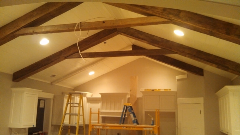 Exposed beams over kitchen
